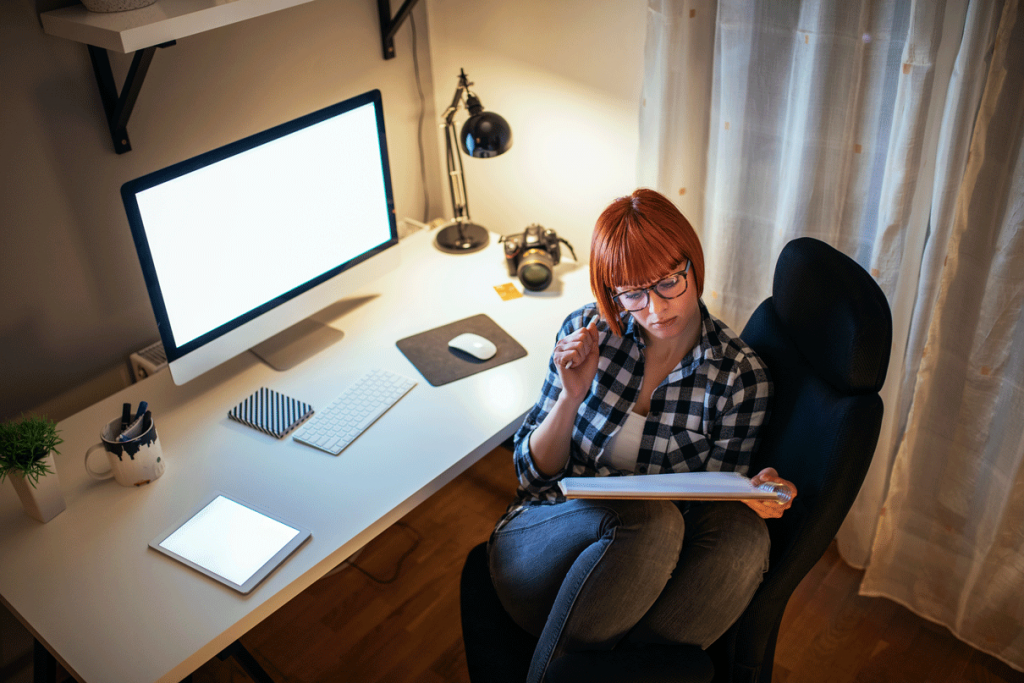 Woman working from home in small office space